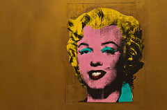 Andy Warhol, Gold Marilyn Monroe, 1962. Pop Art, USA Significance: - A challenge to question whether it is an object or fine art - Gets rid of individual expression of artist - Ironic message - recognizable image of recognizable celebrity put on gold background compared to the past of putting gold behind religious subjects - Iridescent gold on canvas with paint for marilyn's image/silkscreen
