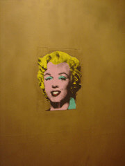 Gold Marilyn Monroe  Andy Warhol Mid 20th Century American  Fascinated with celebrity (and oddly with death). He understood the media and was able to create a public persona that hid his true character. Had an ability to reduce subject matter. Also his art could be mass produced which = $$