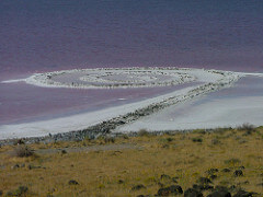 Spiral Jetty  Robert Smithson Late 20th Century American  Sought to take art back to nature -- against the new idea that art is a commodity. Built in remote places so that finding the art is part of the piece. DADAIST and SURREALIST.
